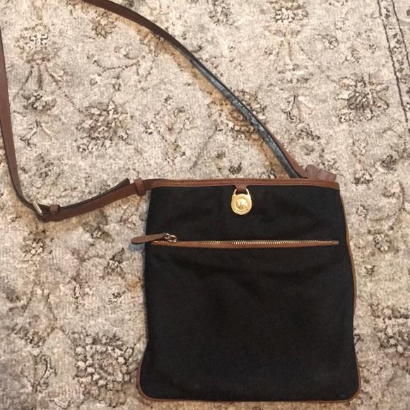 62685ff04986 Michael Kors Kempton Bag in Black with Brown Trim.  M 5a3d322105f430ccad01faff